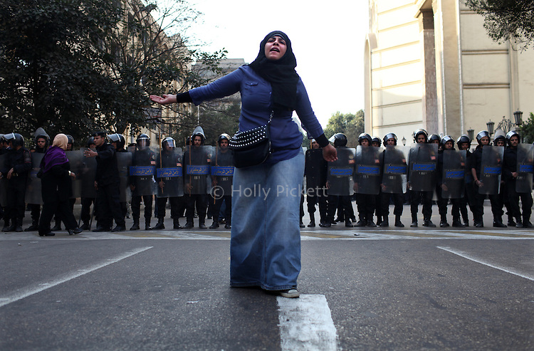 A protester leads chanting in front of a police cordon at the Journalists' Syndicate in downtown Cairo, Egypt, Jan. 26, 2011. Violent clashes between demonstrators and police continued into a second day, as protesters attempted to build momentum in a movement inspired by the recent Tunisian uprising.