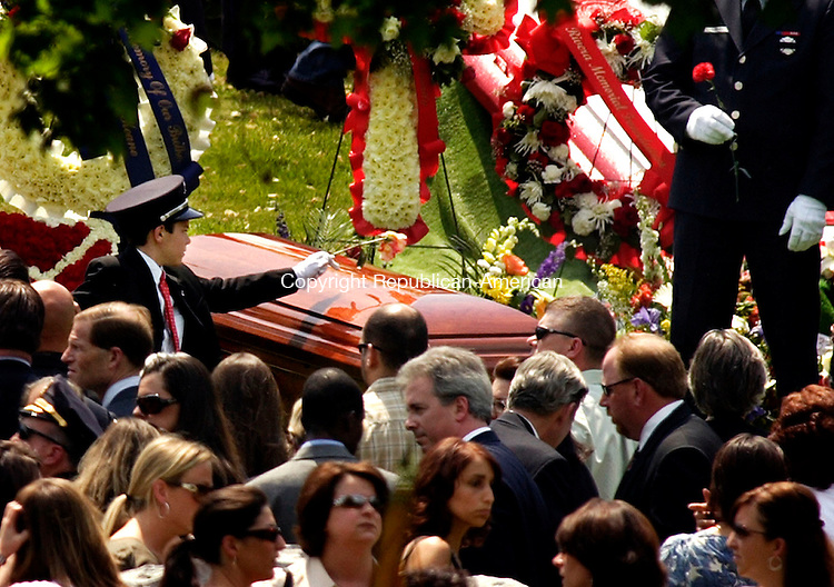 WATERBURY, CT-  25 MAY 2007-052507BF05-- John Keane, son of Waterbury Fire Department Capt. John Keane, places a flower on his fathers casket Friday afternoon at Calvary Cemetery. Capt. Keane died from injuries he received Saturday May 19 when two fire trucks collided at the intersection of E. Aurora Street and Route 73 in Waterbury.   Bob Falcetti Republican-American