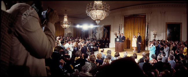 US President Richard Nixon, surrounded by family and staff, makes his resignation speech following the Watergate scandal. East Room, the White House, Washington DC, USA, August 9 1974