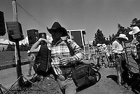 A rodeo competitor leaves the rodeo grounds after the annual Lincoln Rodeo in Lincoln, MT in June 2006.  The Lincoln Rodeo is an open rodeo, which means competitors need not be a member of a professional rodeo association.