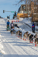 Anja Rodano on Cordova St. hill during the Anchorage start day of Iditarod 2018 on Cordova St. hill during the Anchorage start day of Iditarod 2019