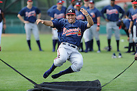 Infielder Eric Garcia (45) of the Atlanta Braves farm system in a Minor League Spring Training sliding drill on Monday, March 16, 2015, at the ESPN Wide World of Sports Complex in Lake Buena Vista, Florida. (Tom Priddy/Four Seam Images)