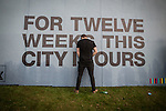 "© Joel Goodman - 07973 332324 . 05/06/2015 . Manchester , UK . A man urinates against a poster reading "" For twelve weeks this city is ours "" . Evening concerts featuring headliners , The Courteeners , playing a homecoming gig , at Heaton Park in Manchester in front of 25,000 people , the evening before the Parklife music festival . Photo credit : Joel Goodman"