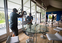 NWA Democrat-Gazette/JASON IVESTER<br /> Drew Clark (left) and Colten Scott, both with Roark Group, set up a television stand Wednesday, June 14, 2017, in the seating area overlooking the 18th green at Pinnacle Country Club in Rogers. Events begin Monday for the LPGA Wal-Mart NW Arkansas Championship.