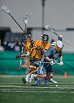 16 April 2016: University of Vermont Catamount Defender Ben Cox, a Junior from Medfield, MA, maintains possession as he is checked by UMBC Defender Jason Brewster, a Freshman from San Diego, CA during a game against the University of Maryland, Baltimore County Retrievers at Virtue Field in Burlington, Vermont. The Catamounts defeated the Retrievers 14-10 in NCAA Division I play. Mandatory Credit: Ed Wolfstein Photo *** RAW (NEF) Image File Available ***