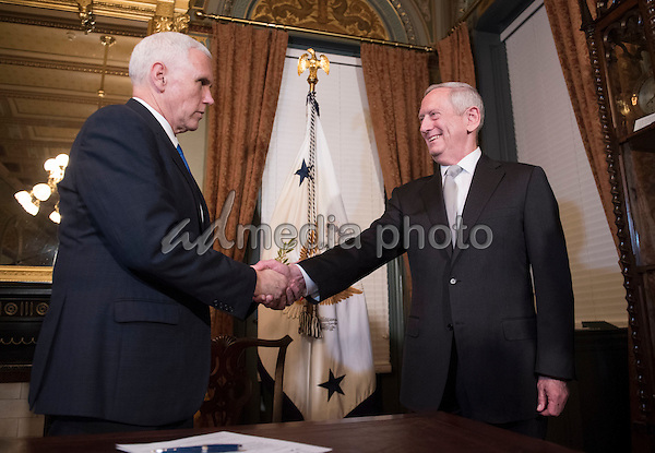 Marine Corps General James Mattis shakes hands with Vice President Mike Pence after being sworn-in as Defense Secretary, in the Vice Presidential ceremonial office in the Executive Office Building in Washington, D.C. on January 20, 2017. Photo Credit: Kevin Dietsch/CNP/AdMedia