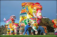 BNPS.co.uk (01202 558833)<br /> Pic: PhilYeomans/BNPS<br /> <br /> Skilled artists from Zigong put the finishing touches to a herd of Elephant.<br /> <br /> The largest Chinese 'Festival of Light' seen in Europe is taking shape at the Longleat House in Wiltshire - A small army of over 50 skillled workers have flown in from the remote village of Zigong in central China to create the stunning spectacle.<br /> <br /> Among the different scenes are a 20-metre tall Chinese temple, a 70-metre-long dragon, created using more than 10,000 porcelain cups, bowls, plates and dishes, and the mythical qilin &ndash; a chimerical hooved creature with the head of a lion &ndash; featuring more than 30,000 glass phials filled with coloured liquid.<br /> <br /> Massive traditional Chinese masks are also featured and there is also a bamboo forest which is home to a family of life-size pandas, giant elephants, zebras, lions and deer as well as giant lotus flowers floating on the lake.<br /> <br /> Filled with thousands of LED lights and handmade by a team of 50 highly-skilled craftsmen from Zigong in China's Sichuan province, the lanterns recreate a magical world of myths and legends.<br /> <br /> Set amid the beautiful backdrop of the landscaped grounds and gardens surrounding Longleat House, the lit structures also spill out on to Half Mile Lake to create a stunning and enchanting experience for visitors.<br /> <br /> It&rsquo;s the first time a festival of this size has taken place in the UK and the Chinese team behind the spectacular event believe its size and complexity make it unique throughout Europe.