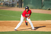Ronald Guzman (22) of the Hickory Crawdads takes his lead off of first base against the Charleston RiverDogs at L.P. Frans Stadium on May 24, 2014 in Hickory, North Carolina.  The Crawdads defeated the RiverDogs 7-3.  (Brian Westerholt/Four Seam Images)