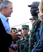Keesler AFB, MS - August 27, 2006 -- Senior Airman Ngwa Ntumngia talks with United States President George W. Bush during a stop at Keesler Air Force Base, Mississippi, on August 27, 2006. The president met Airmen and civilians from Keesler AFB during his visit to the Gulfport region in Mississippi to view the area devastated by Hurricane Katrina one year ago. Airman Ntumngia is an administration specialist with the 81st Medical Operations Squadron and originally from Cameroon.<br /> Credit: Cecilio M. Ricardo - U.S. Air Force via CNP