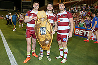 Picture by David Neilson/SWpix.com/PhotosportNZ - 10/02/2018 - Rugby League - Betfred Super League - Wigan Warriors v Hull FC  - WIN Stadium, Wollongong, Australia - Wigan's Tom Davies, Oliver Gildart & Tony Clubb with the Kenny Sterling shield after victory over Hull FC.