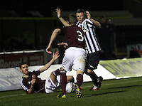 Kevin McHaity (3) and Graeme McGregor challenge for the ball in the St Mirren v Heart of Midlothian Clydesdale Bank Scottish Premier League U20 match played at St Mirren Park, Paisley on 6.11.12.