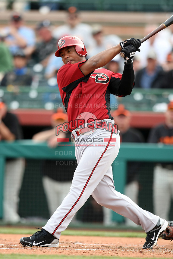 Melvin Mora #4 of the Arizona Diamondbacks bats against the San Francisco Giants in the first spring training game of the season at Scottsdale Stadium on February 25, 2011  in Scottsdale, Arizona. .Photo by:  Bill Mitchell/Four Seam Images.