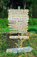 Road signs indicating the direction to various wine producers in Chateauneuf-du-Pape: Feraud, Vaudieu Usseglio Raymond, nalys, Mathieu, Vatican, Pere Caboche, La Font du Loup, Diffonty Remy, Sabon Roger, and La Route du Vin (the wine route)  Chateauneuf-du-Pape Châteauneuf, Vaucluse, Provence, France, Europe  Chateauneuf-du-Pape Châteauneuf, Vaucluse, Provence, France, Europe