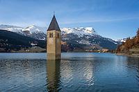 Italy, South-Tyrol (Alto Adige - Trentino), Val Venosta, Old-Graun at Reschen passroad, submerged at Reschen Lake, dammed 1949/1950, at background snowcapped summits of Sevenna Alps | Italien, Suedtirol, Vinschgau, Alt-Graun am Reschenpass, durch Stauung des Reschensees 1949/50 versank das Dorf in den Fluten, nur der Kirchturm schaut heute noch heraus, dahinter die schneebedeckten Gipfel der Sesvennagruppe