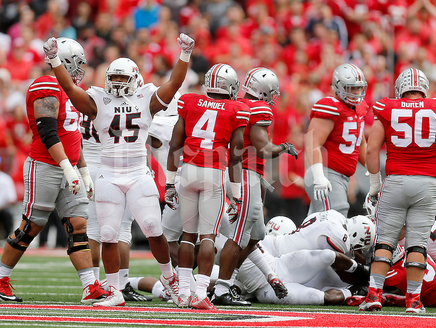 Northern Illinois Huskies linebacker Boomer Mays (45) celebrates his team recovering a fumble by Ohio State Buckeyes running back Ezekiel Elliott (15) during the first half of the NCAA football game between the Ohio State Buckeyes and the Northern Illinois Huskies at Ohio Stadium on Saturday, September 19, 2015. (Columbus Dispatch photo by Jonathan Quilter)