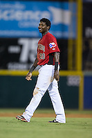 Juremi Profar (23) of the Hickory Crawdads waits for someone to bring him his hat and glove between innings of the game against the Charleston RiverDogs at L.P. Frans Stadium on August 25, 2015 in Hickory, North Carolina.  The Crawdads defeated the RiverDogs 7-4.  (Brian Westerholt/Four Seam Images)