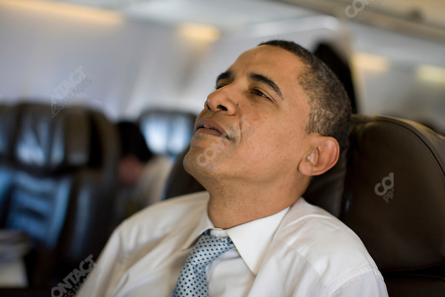 Senator Barack Obama, Democratic presidential candidate, aboard his campaign plane en route to Omaha, Nebraska, February, 7, 2008