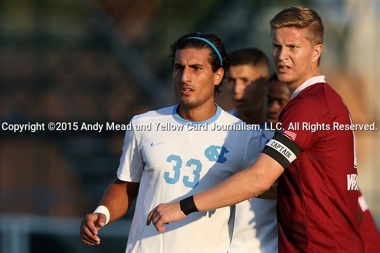 14 August 2015: North Carolina's Raby George (SWE) (33) and Winthrop's Magnus Thorsson (ISL) (right). The University of North Carolina Tar Heels hosted the Winthrop University Eagles at Fetzer Field in Chapel Hill, NC in a 2015 NCAA Division I Men's Soccer preseason exhibition. North Carolina won the game 4-1.