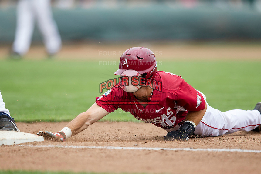 Arkansas Razorbacks outfielder Andrew Benintendi (16) dives back to first base against the Virginia Cavaliers in Game 1 of the NCAA College World Series on June 13, 2015 at TD Ameritrade Park in Omaha, Nebraska. Virginia defeated Arkansas 5-3. (Andrew Woolley/Four Seam Images)
