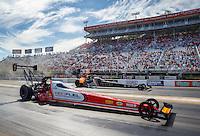 Jun 19, 2016; Bristol, TN, USA; NHRA top fuel driver Shawn Langdon (near) defeats Tony Schumacher during the final round of the Thunder Valley Nationals at Bristol Dragway. Mandatory Credit: Mark J. Rebilas-USA TODAY Sports