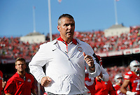 Ohio State Buckeyes head coach Urban Meyer leaves the field for halftime of the NCAA football game at Ohio Stadium in Columbus on Sept. 19, 2015. (Adam Cairns / The Columbus Dispatch)