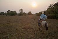 Pantanero, brazilian cowboy, rides his horse in Pantanal Brazil