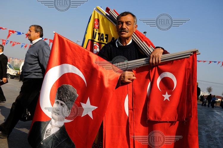 The eponymous flag seller on the Eminonu waterfront, with Turkish flags, including a version emblazoned with Ataturk.