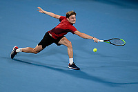 10th January 2020; Sydney Olympic Park Tennis Centre, Sydney, New South Wales, Australia; ATP Cup Australia, Sydney, Day 8; Belgium versus Spain;David Goffin of Belgium versus Rafael Nadal of Spain; David Goffin of Belgium stretches for a backhand to Rafael Nadal of Spain - Editorial Use