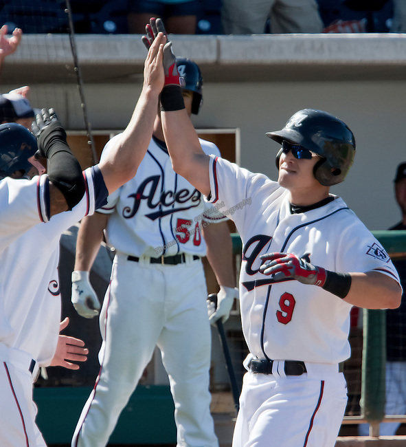 Reno Aces Mike Jacobs is congratulated by teammates after hitting a three run home run to break up a 3-3 tie in the bottom of the 7th inning against the Sacramento River Cats during their play off game played on Sunday afternoon, September 9, 2012 in Reno, Nevada.