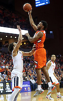 Clemson forward Jaron Blossomgame (5) shoots over Virginia forward Anthony Gill (13) during an ACC basketball game Tuesday Jan. 19, 2016, in Charlottesville, Va. (Photo/Andrew Shurtleff)