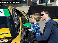 NWA Democrat-Gazette/BEN GOFF @NWABENGOFF<br /> Brendan Morrissey of Bentonville holds his son Jack Morrissey, 3, so he can see inside a IMSA GT Daytona class race car from the Heinricher Racing with Meyer Shank Racing, a team with all women drivers, Friday, May 10, 2019, in front ot 21C Museum Hotel during the Bentonville Film Festival.