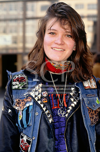 """Brno, Czech Republic. Teenage girl in leather jacket and denim """"Hell's Angels"""" outfit."""