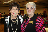 NWA Democrat-Gazette/CARIN SCHOPPMEYER Joy Sanders (left) and Leah Whitehead, Bentonville Garden Club president, welcome guests to the group's annual auction and luncheon.