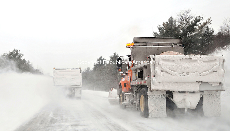 TORRINGTON, CT-012809JS03-State Department of Transportation trucks clear the roads on Route 8 in Torrington on Wednesday after a storm dumped snow and freezing rain throughout the state.  <br /> Jim Shannon / Republican-American