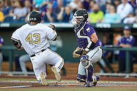 TCU Horned Frogs catcher Evan Skoug (9) blocks the plate as Vanderbilt Commodores baserunner Zander Wiel (43) scores in Game 12 of the NCAA College World Series on June 19, 2015 at TD Ameritrade Park in Omaha, Nebraska. The Commodores defeated TCU 7-1. (Andrew Woolley/Four Seam Images)