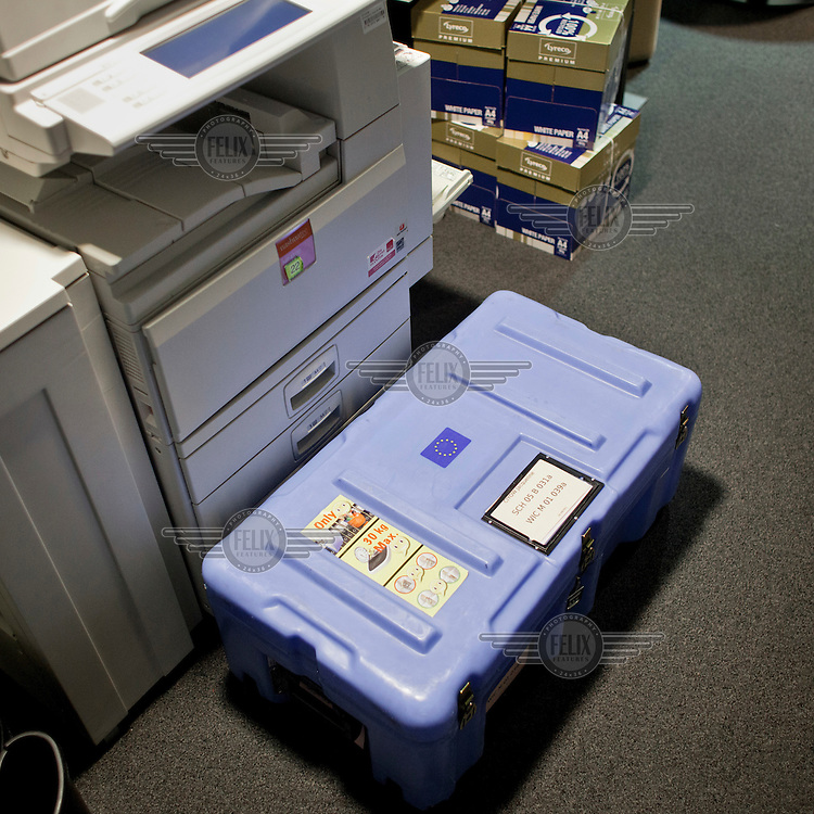 A container, known as a 'cantine', in which official documents are transported between European sites in Brussels, Strasbourg and Luxembourg, sits in an office in the European Parliament waiting for its owner to arrive. Every month thousands of the parliament's employees travel back and forth between the three sites of European government, Brussels, Strasbourg and Luxembourg, bringing huge quantities of paperwork with them.