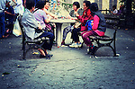 A group of Asian women playing cards after work in a park in Chinatown. Manhattan,  New York City.
