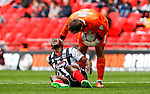James McKeown of Grimsby Town (right) shows concern for Aristote Nsiala of Grimsby Town (left) during the 2015 Vanarama Conference Promotion Final match between Grimsby Town and Bristol Rovers at Wembley Stadium, London<br /> Picture by David Horn/eXtreme aperture photography +44 7545 970036<br /> 17/05/2015