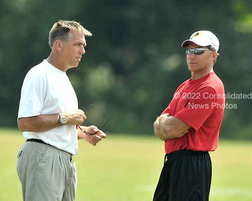 Ashburn, VA - August 4, 2009 -- Head coach Jim Zorn, left, and Executive Vice President of Football Operations Vinny Cerrato, right converse during the 2009 Washington Redskins training camp at Redskins Park in Ashburn Virginia on Monday, August 4, 2009..Credit: Ron Sachs / CNP