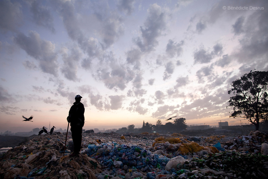 13 february 2013 - Dandora dumpsite, Nairobi, Kenya - A Kenyan man at the Dandora dumpsite, one of the largest and most toxic in Africa. Located near slums in the east of the Kenyan capital Nairobi, the open dump site was created in 1975 and covers 30 acres. The site receives 2,000 tonnes of unfiltered garbage daily, including hazardous chemical and hospital wastes. It is a source of survival for many people living in the surrounding slums, however it also harms children and adults' health in the area and pollutes the Kenyan capital. Photo credit: Benedicte Desrus