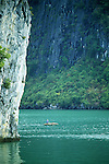 Halong Bay 01 - Small boat on green waters among limestone islands, Halong Bay, Viet Nam