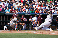 Mississippi State first baseman Wes Rea (35) slides home as Oregon State catcher Jake Rodriguez (13) waits to tag him out during Game 11 of the 2013 Men's College World Series against the Oregon State Beavers on June 21, 2013 at TD Ameritrade Park in Omaha, Nebraska. The Bulldogs defeated the Beavers 4-1, to reach the CWS Final and eliminating Oregon State from the tournament. (Andrew Woolley/Four Seam Images)