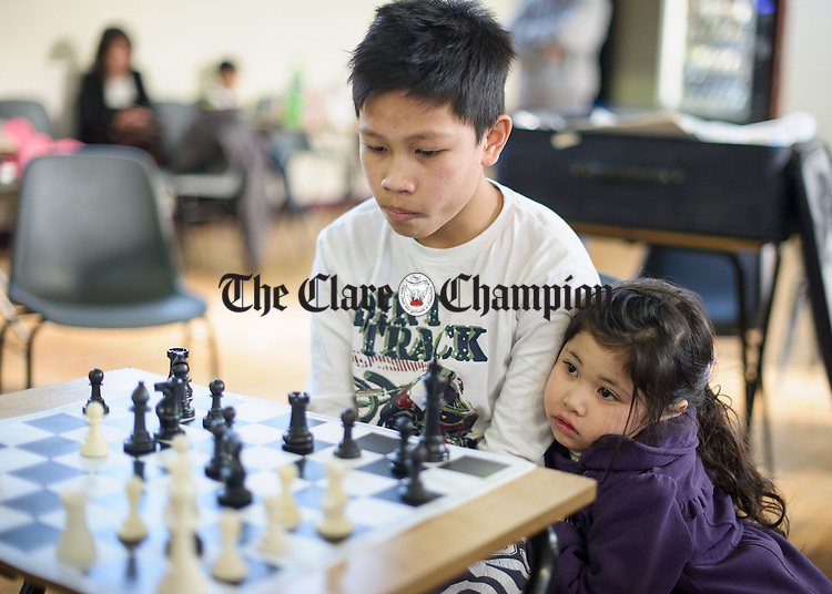 Shannon's Joseph Cesar competing with the support of his little sister Charize, at the Clare Community games chess county finals in St Flannan's college, Ennis. Photograph by John Kelly.