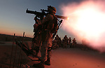 After the detonation of a parked car bomb the day before,  a Marine from Golf Co. 2nd Battalion 1st Marines fires a shoulder-fired rocket at a suspect vehicle during the fifth day of Operation Steel Curtain, an operation to clear Husaybah (a city on the Iraq-Syrian border) of insurgents on Wed. Nov. 9, 2005.