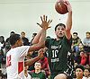 Alex Merhige #10 of Harborfields drives to the net for two points during a Suffolk County varsity boys basketball game against host Amityville High School on Thursday, Jan. 12, 2017. He scored 28 points in Harborfields' 81-41 win.