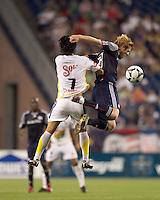 New England Revolution defender Pat Phelan (28) battle for head ball. The New England Revolution defeated Monarcas Morelia in SuperLiga 2010 group stage match, 1-0, at Gillette Stadium on July 20, 2010.