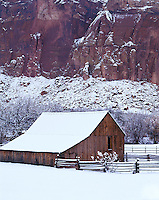 Capitol Reef National Park, UT<br /> Fresh snowfall covers the Gifford Barn under the towering cliffs of Capitol Reef