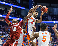 NWA Democrat-Gazette/BEN GOFF @NWABENGOFF<br /> Daniel Gafford (10), Arkansas forward, and Jalen Hudson, Florida guard, chase a rebound in the second half Thursday, March 14, 2019, during the second round game in the SEC Tournament at Bridgestone Arena in Nashville.