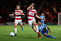 Blackpool's Joe Nuttall scuffs a shot under pressure from Doncaster Rovers' Tom Anderson<br /> <br /> Photographer Alex Dodd/CameraSport<br /> <br /> The EFL Sky Bet League One - Doncaster Rovers v Blackpool - Tuesday September 17th 2019 - Keepmoat Stadium - Doncaster<br /> <br /> World Copyright © 2019 CameraSport. All rights reserved. 43 Linden Ave. Countesthorpe. Leicester. England. LE8 5PG - Tel: +44 (0) 116 277 4147 - admin@camerasport.com - www.camerasport.com