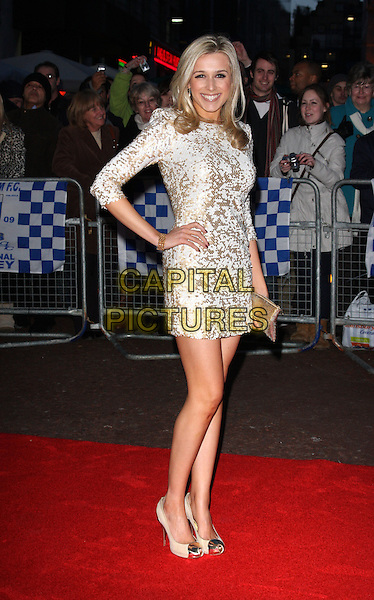 LARA LEWINGTON .UK Film Premiere of 'The Shouting Men' at the Odeon West End, Leicester Square, London, England, UK, .March 2nd 2010.Arrivals  full length dress hand on hip sleeves metallic shoes heels toe cap clutch bag smiling white gold sequined sequin.CAP/ROS.©Steve Ross/Capital Pictures.